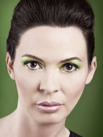Portrait of a beautiful fashion woman over a green background Stock Photo - 19428625