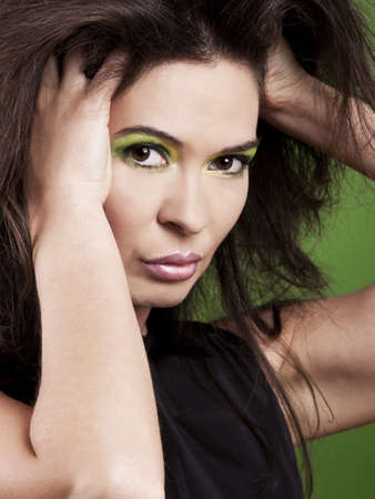 Portrait of a beautiful fashion woman over a green background photo