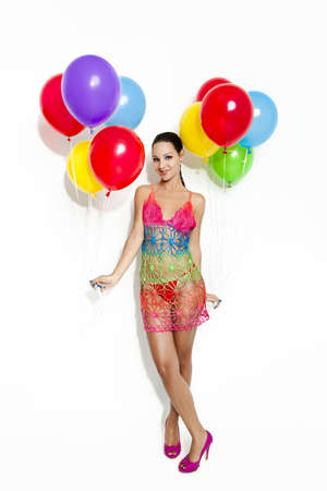 Fashion portrait of a beautiful young women posing with ballons, isolated on white Stock Photo - 19428669