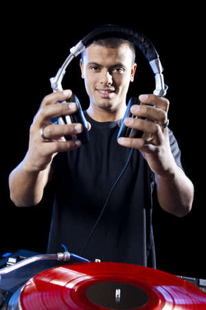 dj boy: Portrait of a DJ playing disco electro music in a concert