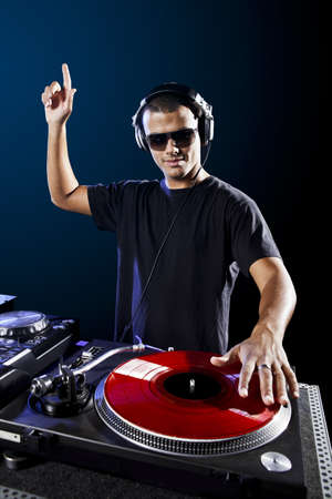 dj turntable: Dj playing disco electro music in a concert