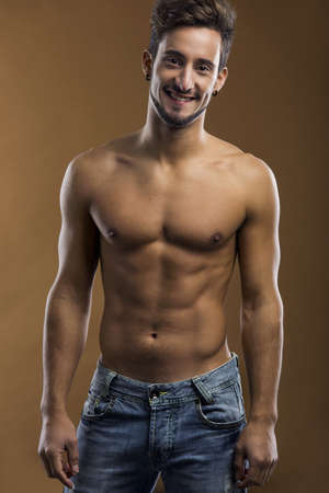 Shirtless male model smiling to the camera photo