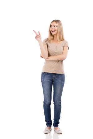 笑って、白い背景上分離に右向きの金髪美人 写真素材