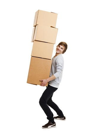 Portrait of a handsome young man holding card boxes, isolated on white Фото со стока