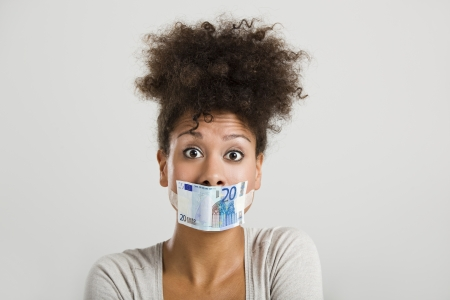 African woman covering her mouth with a euro banknote, great concept for the global crises