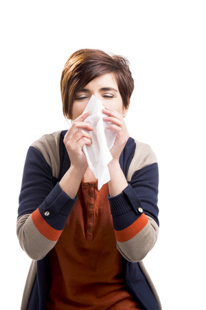 Portrait of a woman with flu, isolated over a white background Stock Photo
