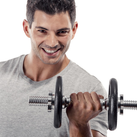 Portrait of a muscular man lifting weights, isolated over a white background Stock Photo - 24224334