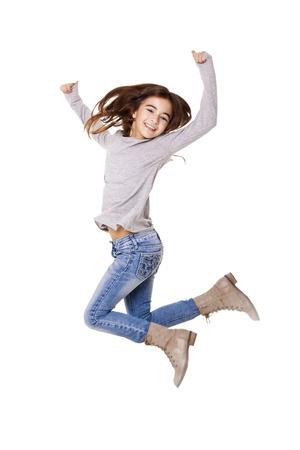 白い背景上にジャンプの女の子