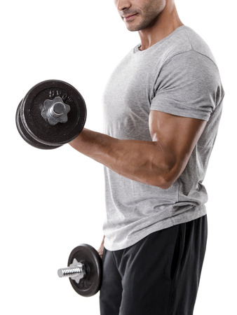 Portrait of a muscular man lifting weights, isolated over a white background Фото со стока