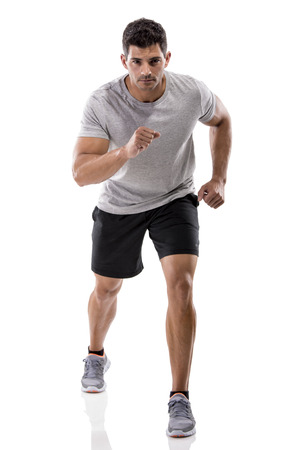 An athletic man running, isolated over a white background Фото со стока
