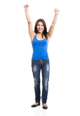 Beautiful and happy woman with arms up, isolated over a white background