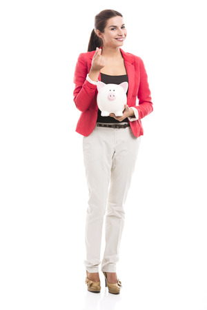Business woman holding a piggy bank on the hands, isolated over a white background Imagens