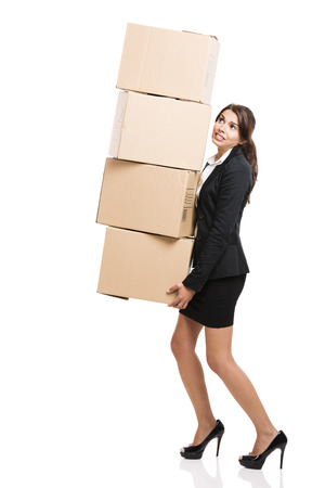Business woman carrying card boxes, isolated over white background
