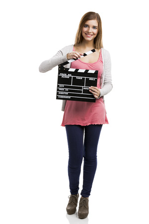 Beautiful blonde woman holding  a clapboard, isolated over white background Banco de Imagens