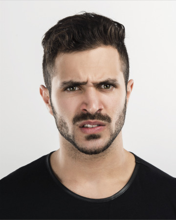 Studio portrait of a handsome young man astonished with a upset expression Stok Fotoğraf