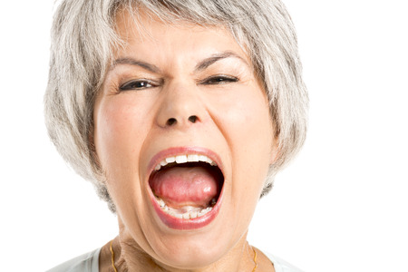 Portrait of a elderly woman with a yelling expression Stockfoto