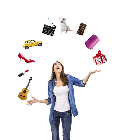 Happy woman trying to catch something falling from the sky Stock Photo