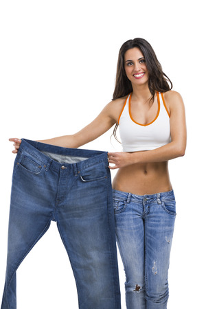 Woman with large jeans in dieting concept Imagens