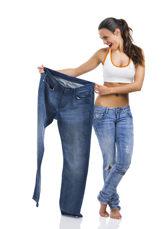 Woman with large jeans in dieting concept Foto de archivo
