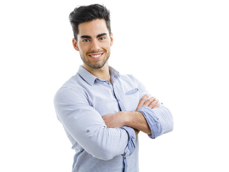 Portrait of happy handsome young man with arms crossed, isolated on white background Фото со стока