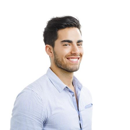행복 잘 생긴 젊은 남자의 초상화는 흰색 배경에 고립