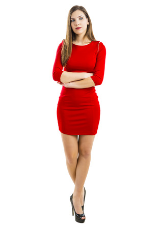 Beautiful and attractive woman with a sexy dress, isolated on white background Standard-Bild
