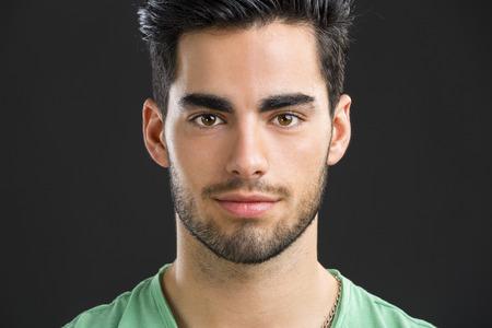 ハンサムな若い男が、白い背景で隔離のクローズ アップの肖像画 写真素材