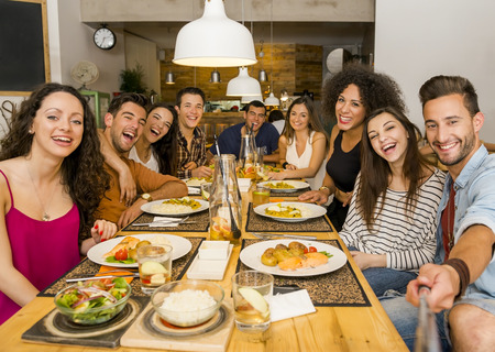Multi-Ethnic group of happy friends lunching and making a selfie