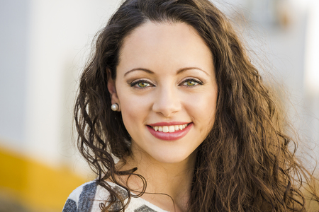 Outdoor portrait of a beautiful and fresh young woman