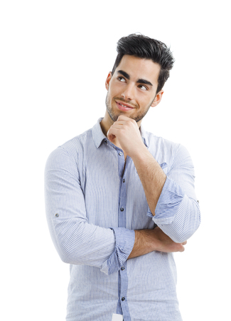 何か、白い背景で隔離の考えるハンサムな若い男の肖像 写真素材