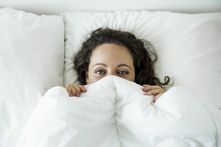 Beautiful woman in the bed and smiling by the morning Stockfoto