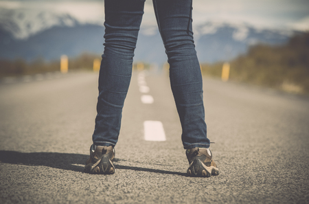 Shoot of a female legs in the center of a road