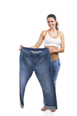 Woman with large jeans in dieting concept Stock Photo