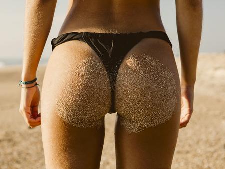 Rearview of a hot woman in bikini