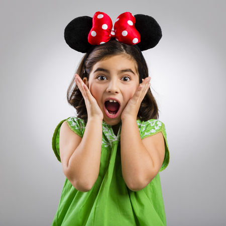 Studio portrait of a little girl with mouse ears