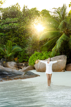 Beautiful woman enjoying the beautiful beachs of Praslin, Seychelles