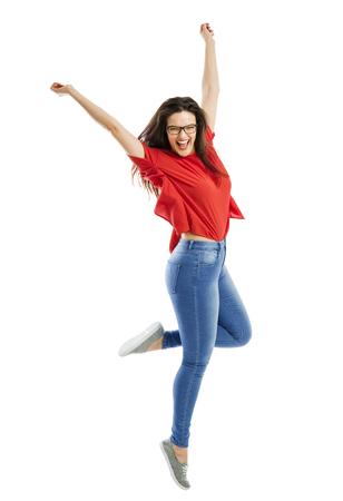 Piękny szczęśliwa kobieta skoków radości Zdjęcie Seryjne