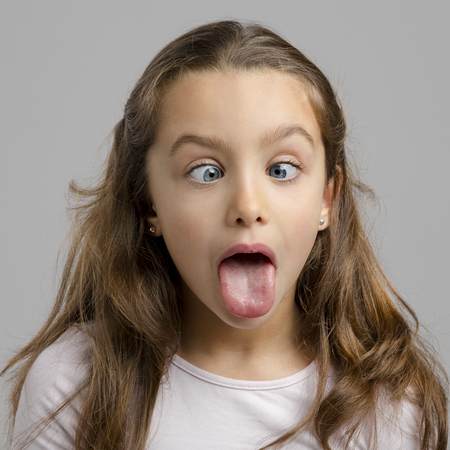 Portrait of a little girl with a funny expression