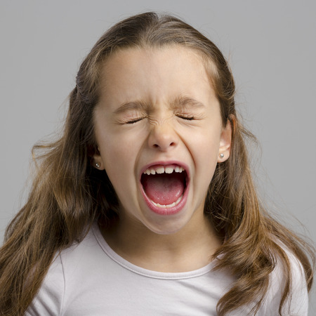 Studio portrait of a little girl yelling