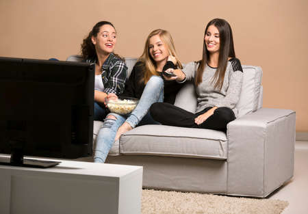 Girls watching movies with popcorn Stok Fotoğraf
