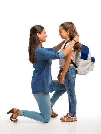 Mother comforting her daughter on the first day of school Stockfoto