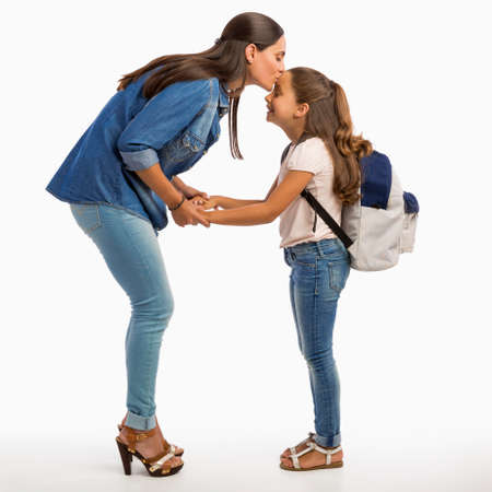 Mother comforting her daughter on the first day of school Stock Photo