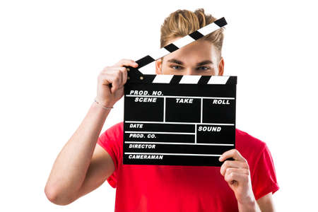 Portrait of a handsome young man wolding a clapboard