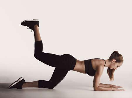 Shot of a young woman doing leg exercises