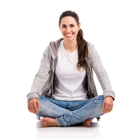 Happy beautiful woman sitting on the floor Stock Photo