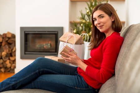 Beautiful woman at home making the last things for Christmas Stock Photo