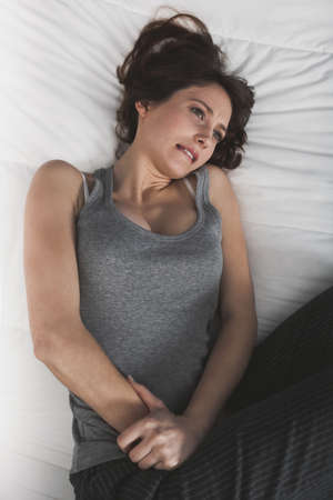 Young girl in pain with PMS, Premenstural Syndrome Stock Photo