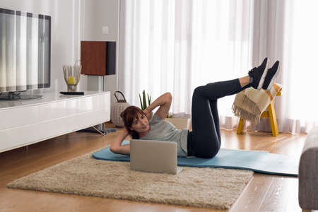 Full length shot of a woman doing exercise at home Banque d'images