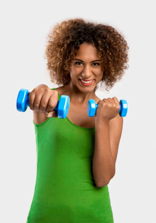 Beautiful African American woman lifting weights