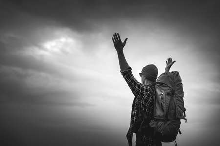 TraveMan Traveling Backpack with arms raised feeling the gratitude
